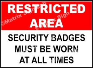 Restricted Area - Security Badges Must Be Worn At All Times Sign
