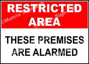 Restricted Area - These Premises Are Alarmed Sign